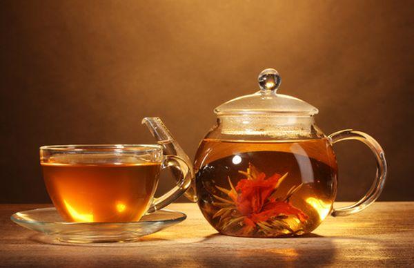 Чай цветок распускается